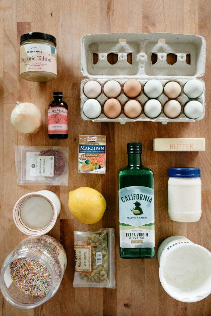 Eggs, olive oil and other food ingredients neatly arranged.