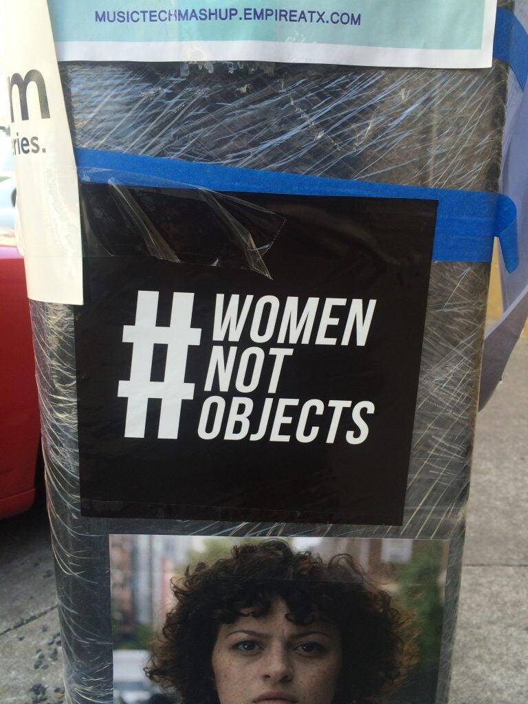 A sign that says #womennotobjects