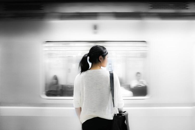 woman watching train pass