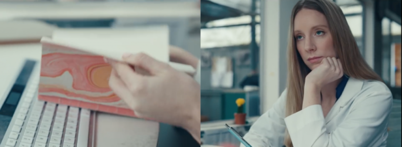 Screen capture from IBM ad - bored looking woman sitting at a desk