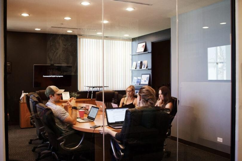 Small group of people sitting at a table in a conference room