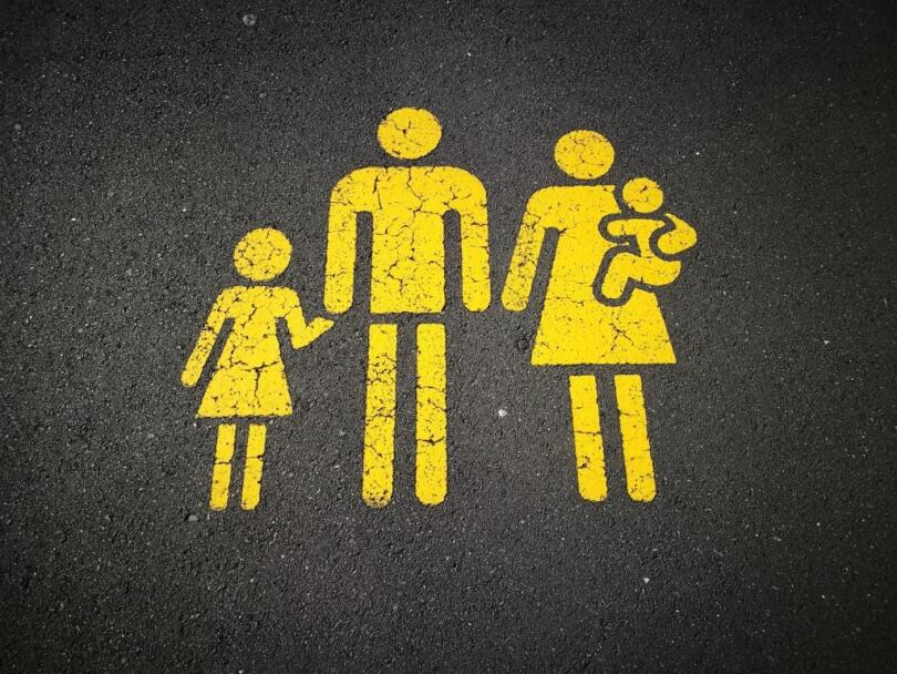 Painted sign of a stick figures of a family
