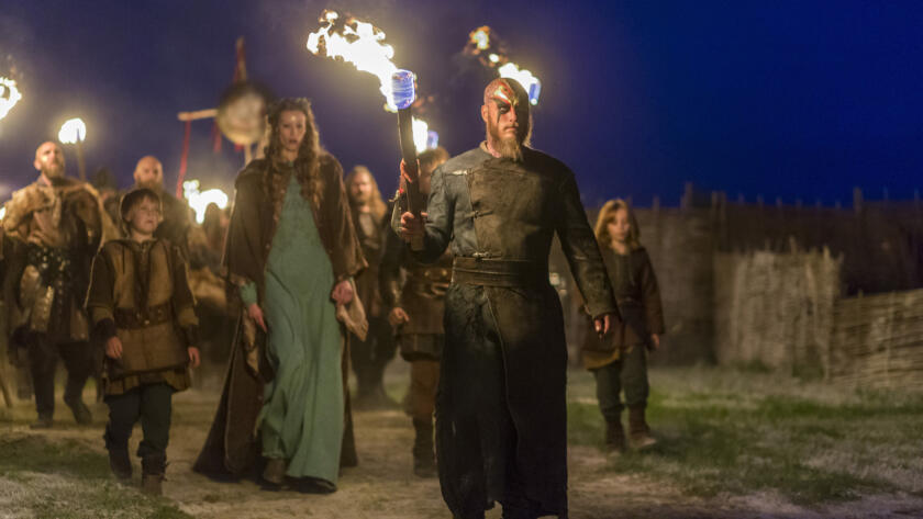 Travis Fimmel as Ragnar, Alyssa Sutherland as Aslaug, Vikings