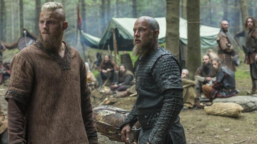 Alexander Ludwig as Bjorn, Travis Fimmel as Ragnar, Vikings
