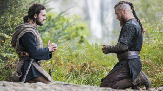 George Blagden as Athelstan, Travis Fimmel as Ragnar, Vikings