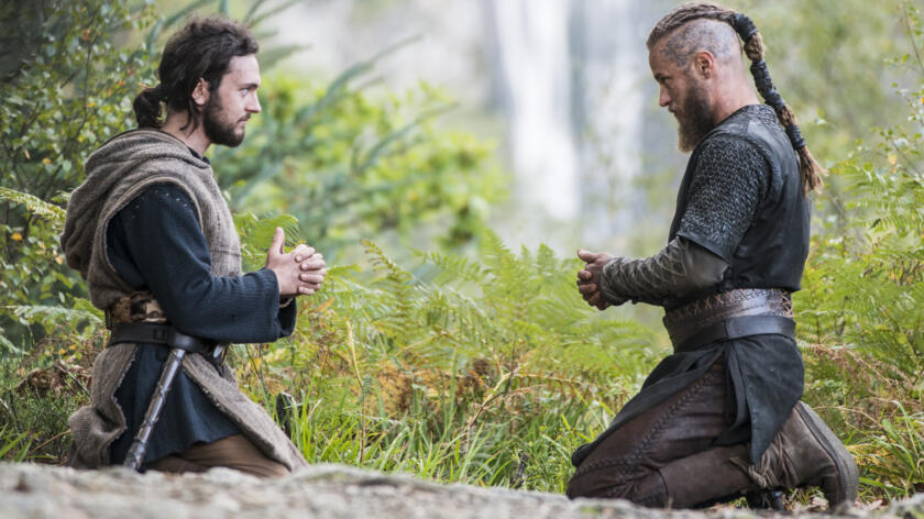 George Blagden as Athelstan, Travis Fimmel as Ragnar, Vikings