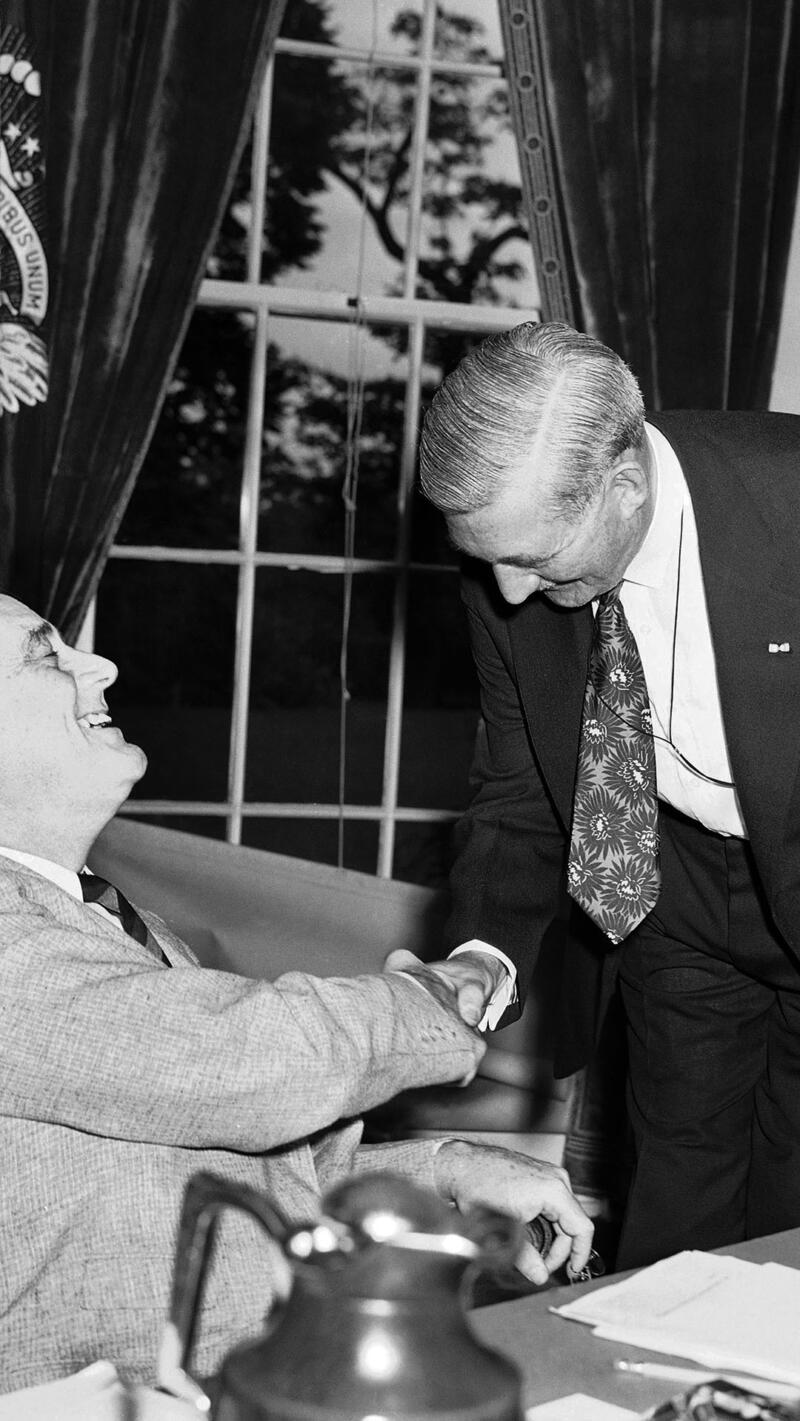 William Knudsen meeting with President Franklin D. Roosevelt.