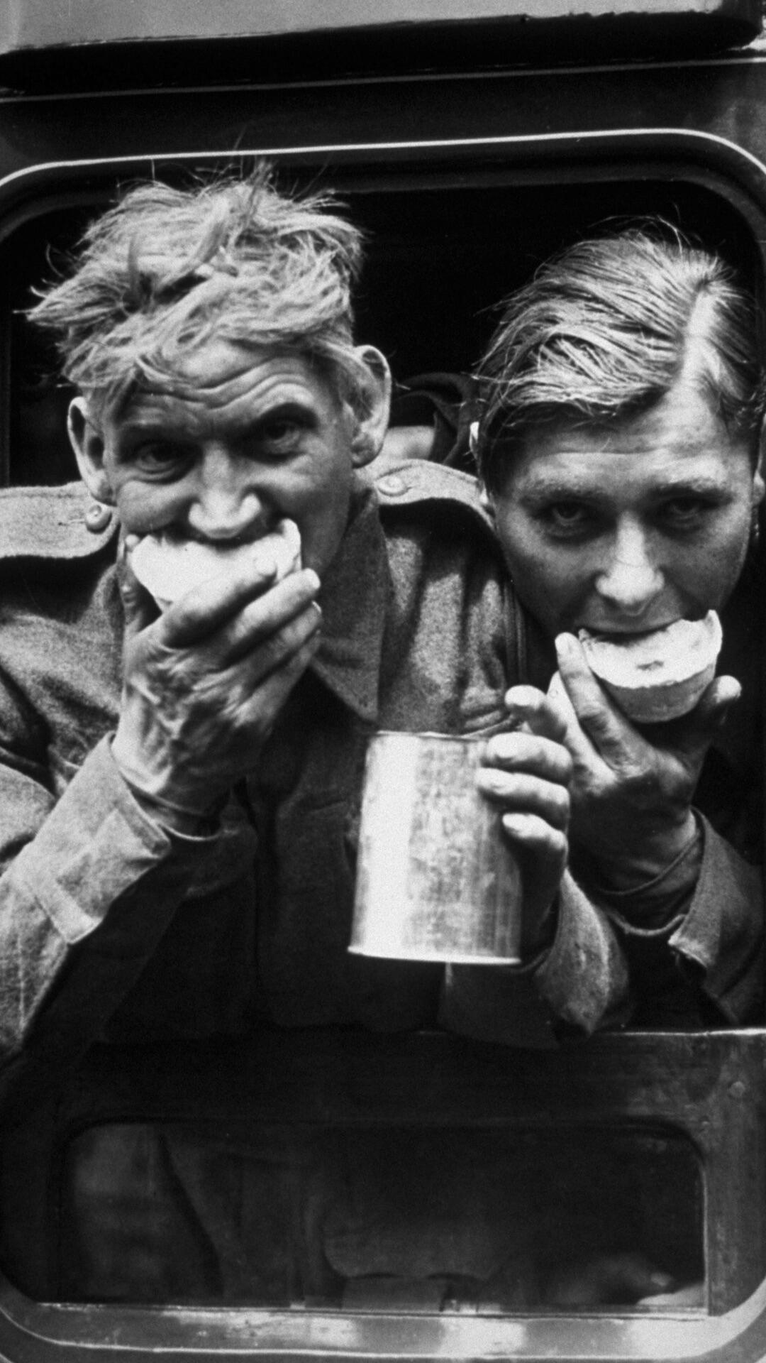 Two soldiers enjoying refreshments