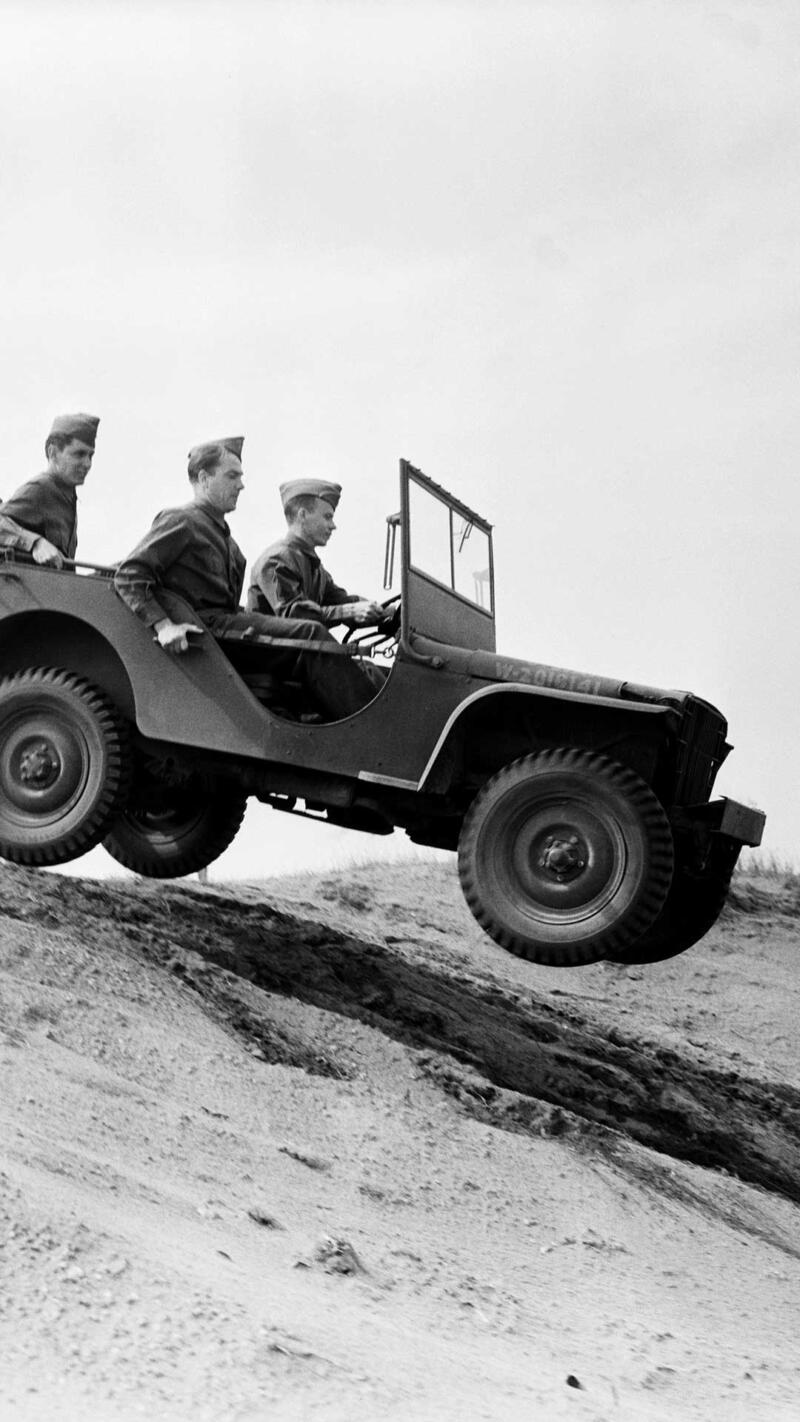 Bantam Jeep car negotiating rough terrain.