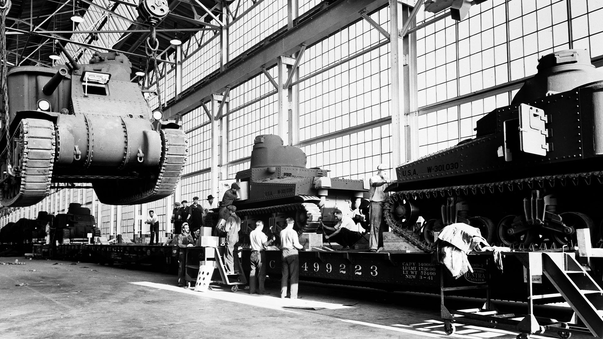 Workers at a Chrysler plant assemble tanks.