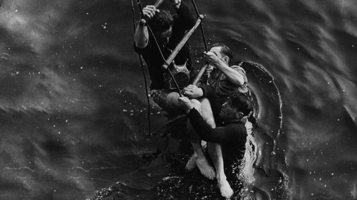 3 men being rescued.