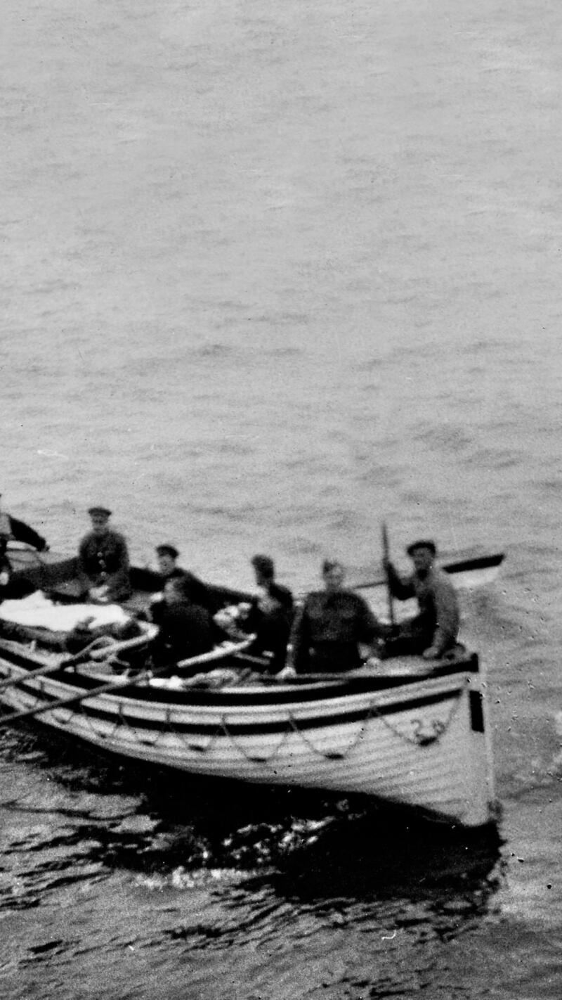 Wounded soldiers in a life boat.