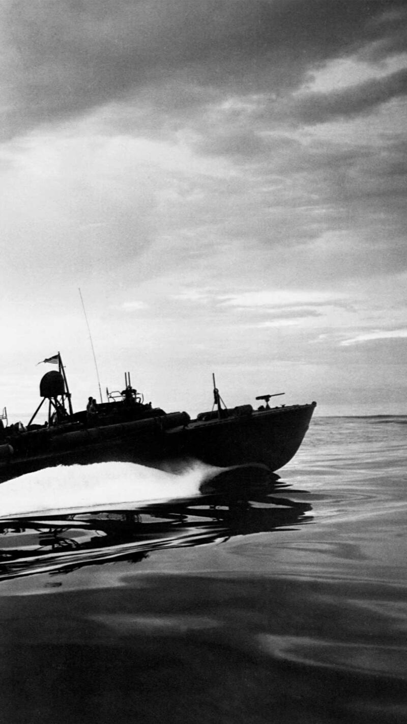 A PT boat patrolling the waters along the coast of New Guinea, 1943.