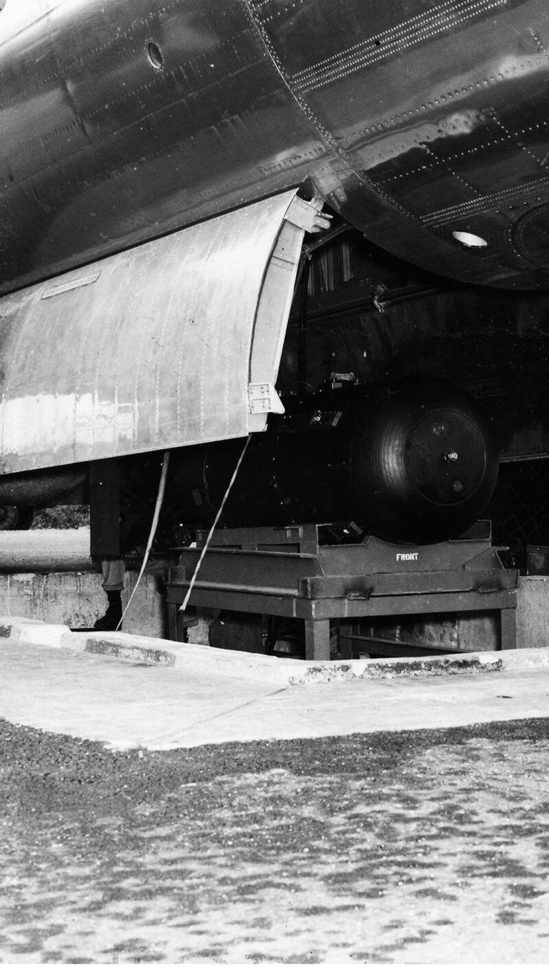 The atomic bomb, codenamed 'Little Boy', as it is hoisted into the bomb bay of the Enola Gay.