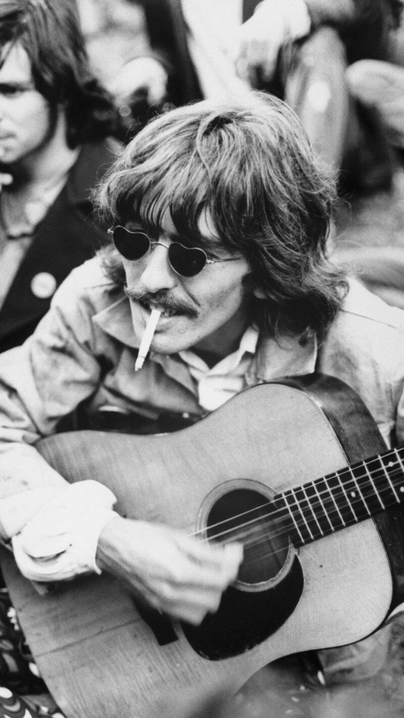 George Harrison Playing Guitar