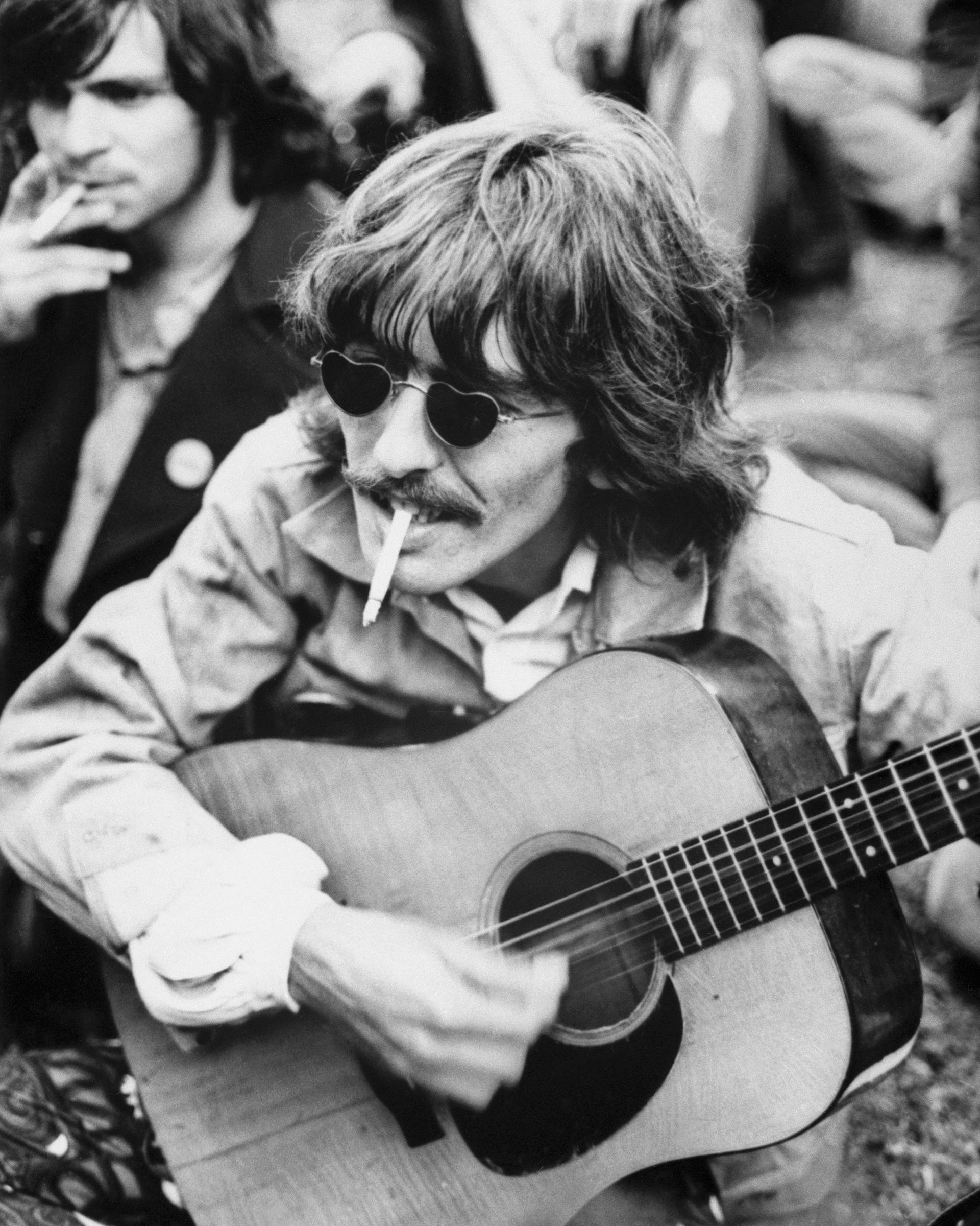 George Harrison Playing Guitar