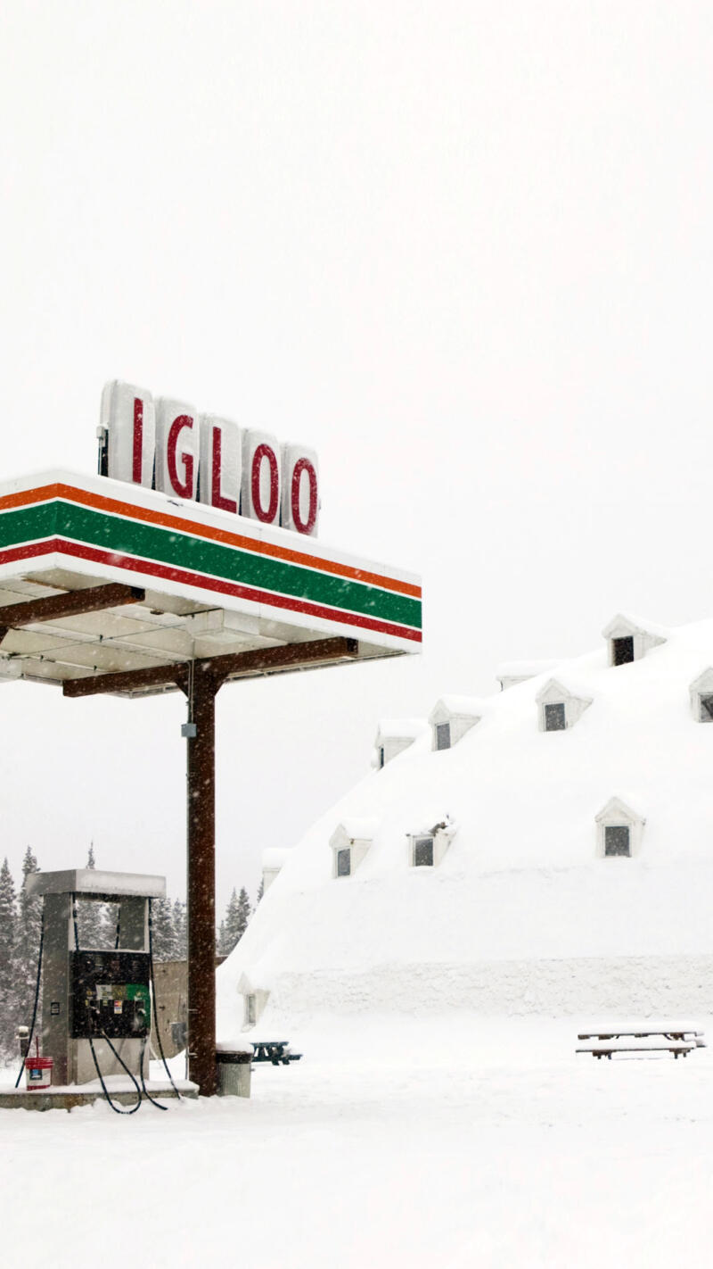 "gas station sits attached to ""Igloo City,"" a hotel in Cantwell"
