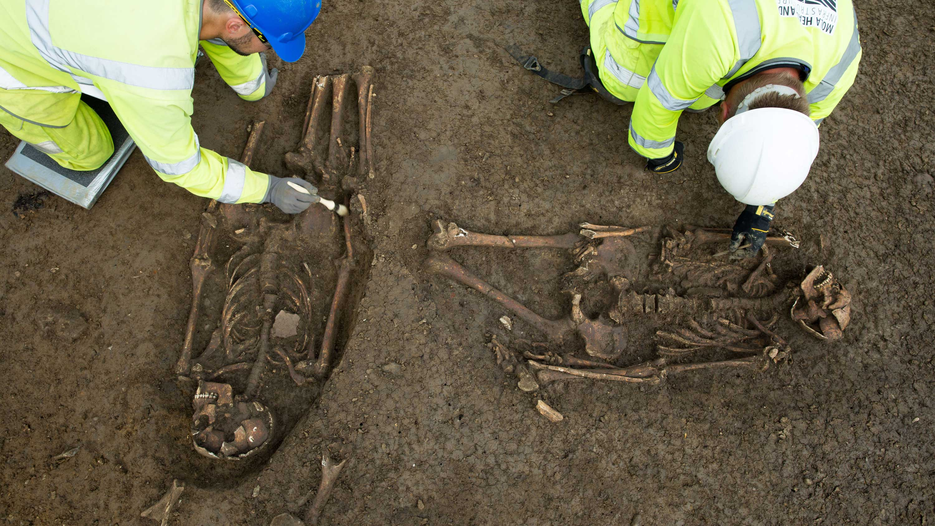 A set of unusual Roman burials being carefully excavated by archaeologists. (Credit: Highways England/MOLA Headland Infrastructure)