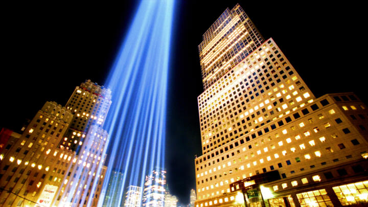 looking up at the beams of light used to memorialize the World Trade Center after the September 11th attacks