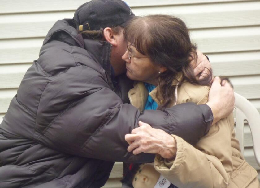 Bobby hugging his Hoarder mother Phyliss