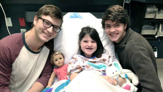 Reed and Cole Robertson from Duck Dynasty with their sister Mia in the hospital