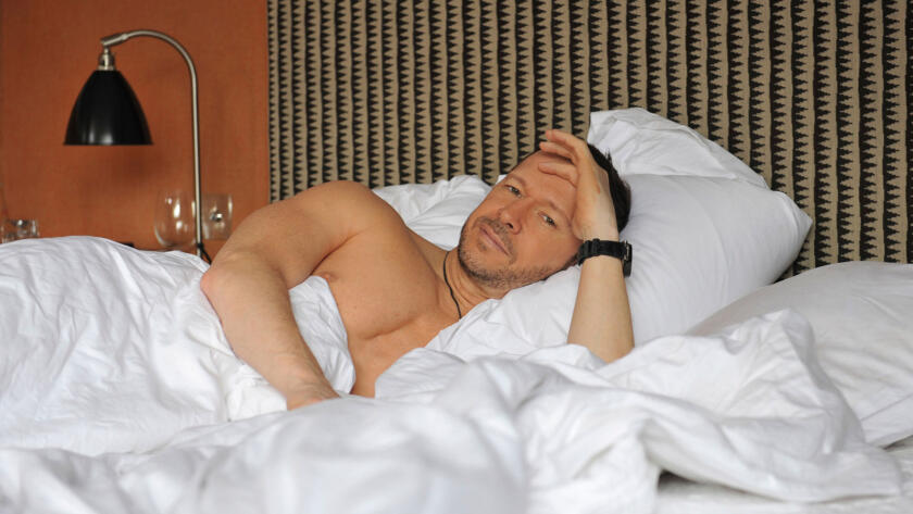 Donnie relaxes in bed