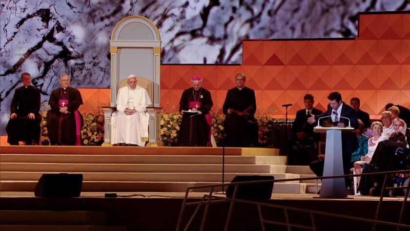 The Pope watches Mark speak.
