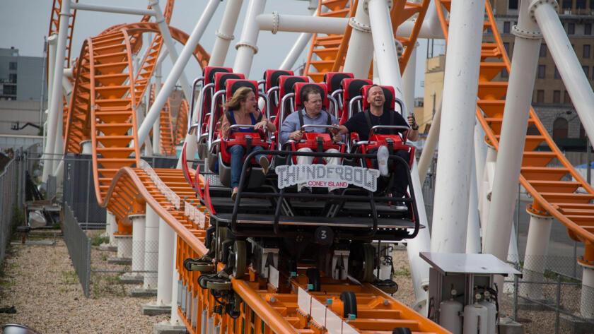 The gang rides a roller coaster.