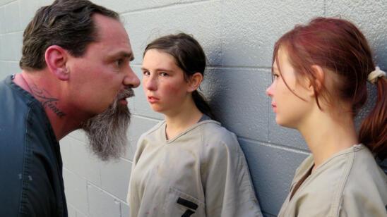 An inmate gives a warning