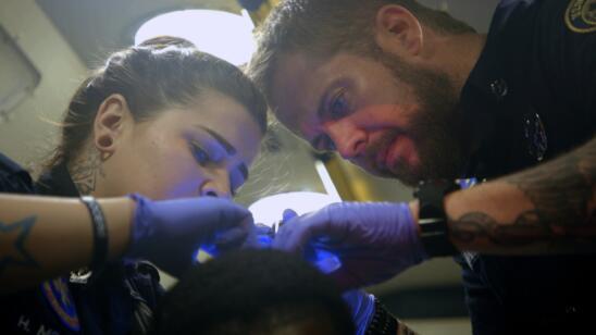 Nick and Holly check a gunshot victim
