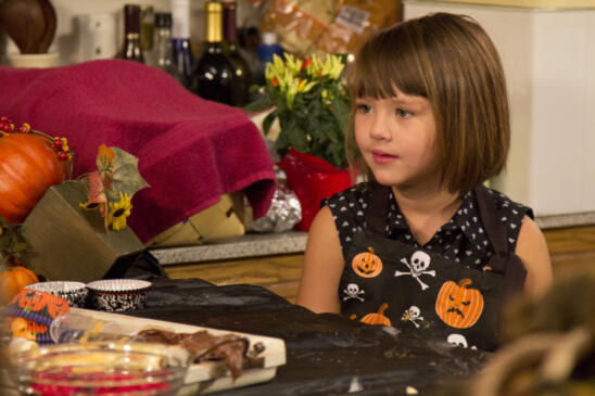 Jep and Jessica's daughter Priscilla hangs out in the kitchen as her grandma Kay creates Halloween treats.