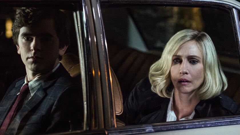 Norman and Norma watch as Madeleine and Sam drive away.