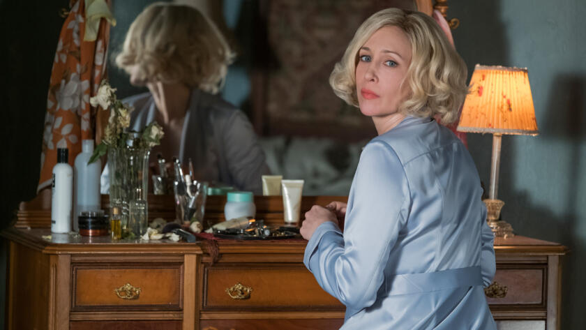 For a moment, he can see Norma sitting at the mirror.