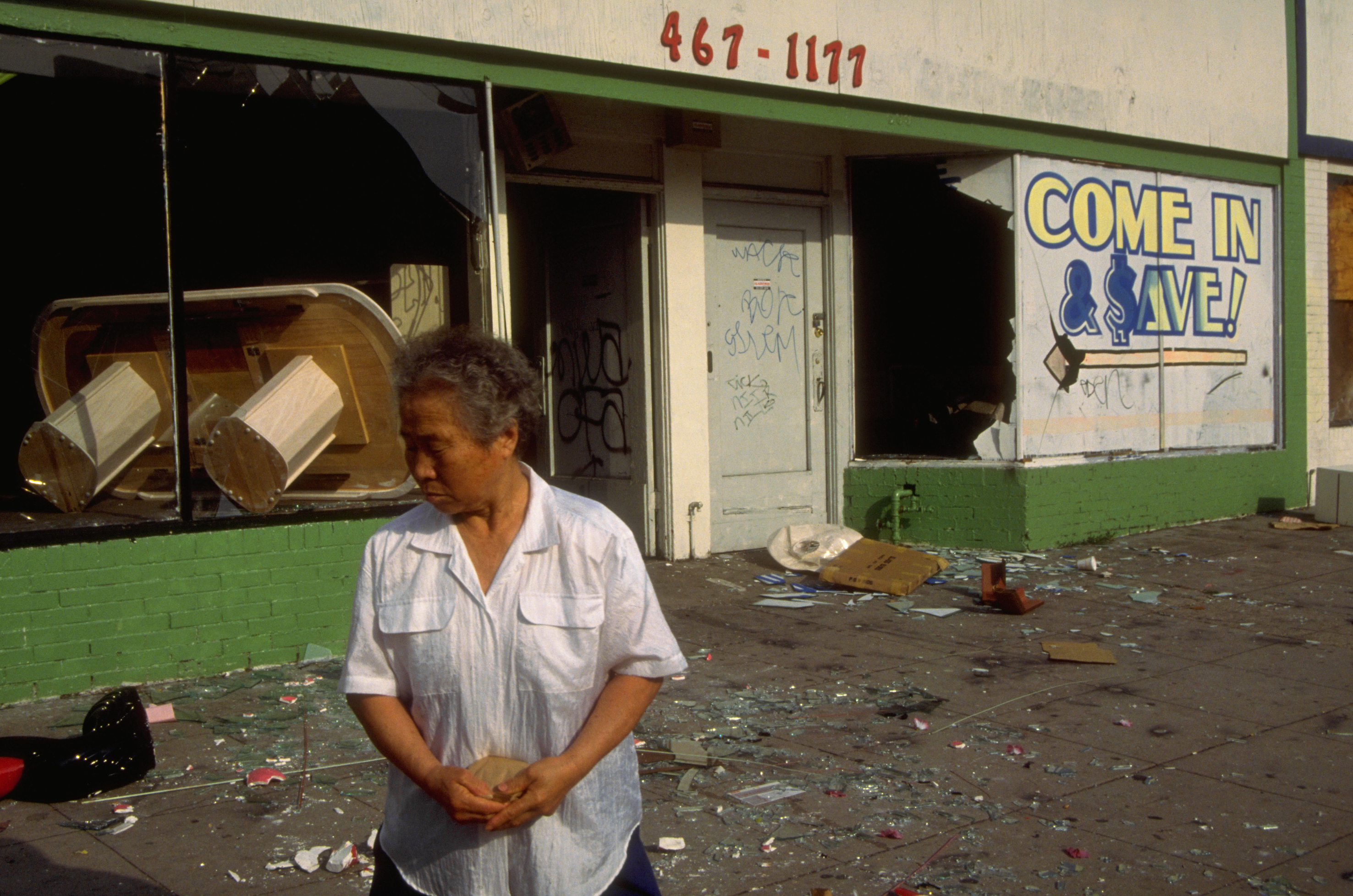 Woman outside of a destroyed business after the L.A. riots