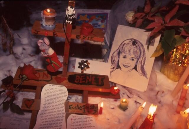 People light candles at the murder site of 6 year old JonBenet Ramsey in Boulder, Colorado, December 1997.