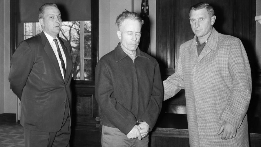 Ed Gein standing with his attorney
