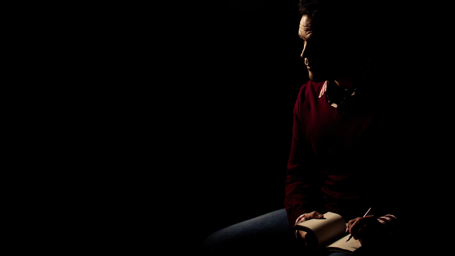 Someone writing in the dark