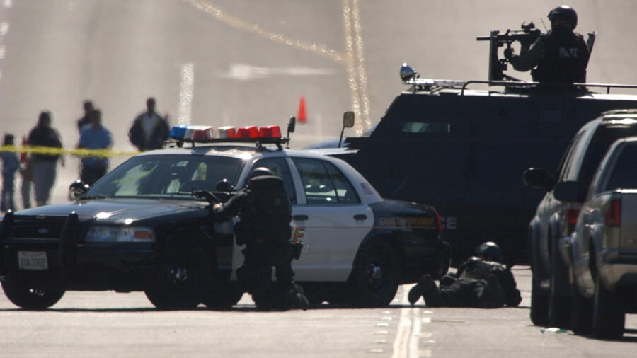 A SWAT team outside of a business where hostages were being held