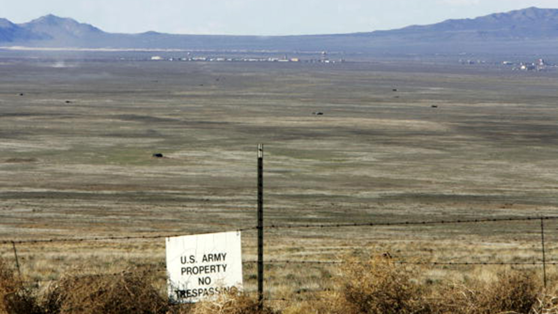 A warning sign marks the boundary of Dugway Proving Ground in the middle of Rush Valley.