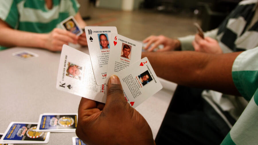 Inmates playing with cold case cards