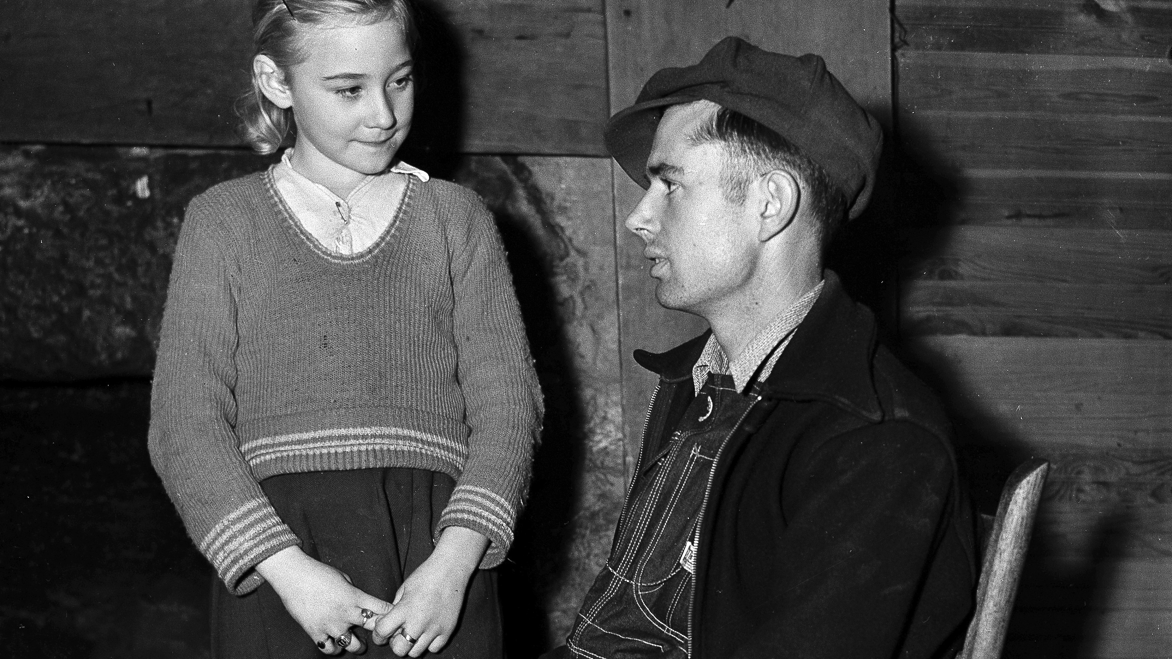 Nine-year-old Eunice Winstead Johns and her 6-foot-tall husband, Charlie Johns, 22, are shown at their home in Sneedville, Tennessee, Feb. 2, 1937.