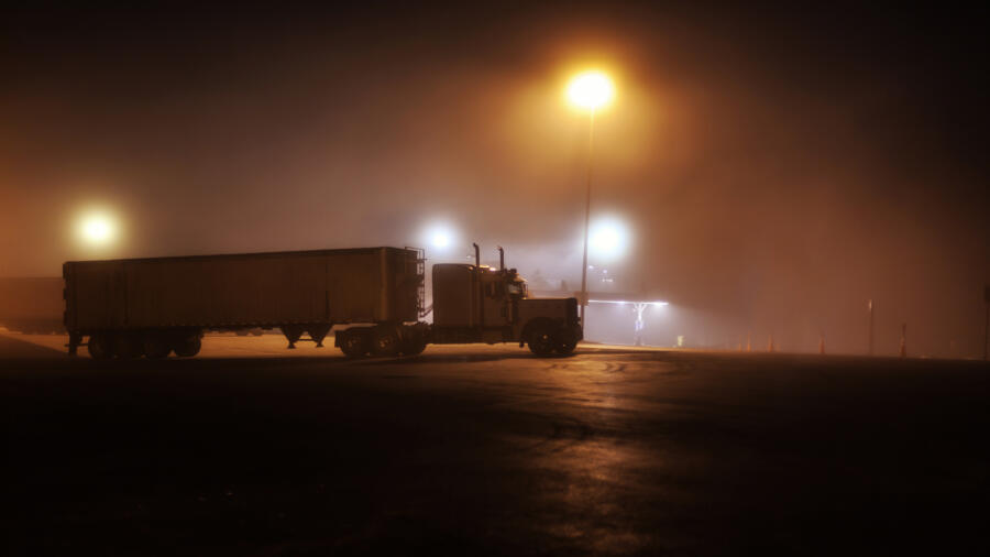 Truck at a foggy rest stop