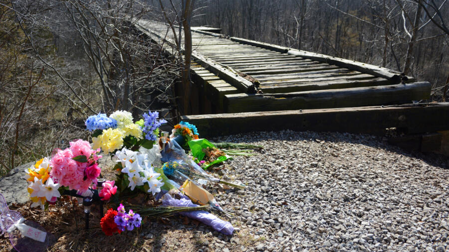Flowers lie at the Monon High railroad bridge in Delph, Indiana near the scene of the double homicide of Liberty German and Abigail Williams