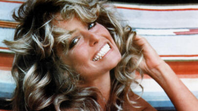 The Story Behind Farrah Fawcett's Iconic 1976 Swimsuit Poster