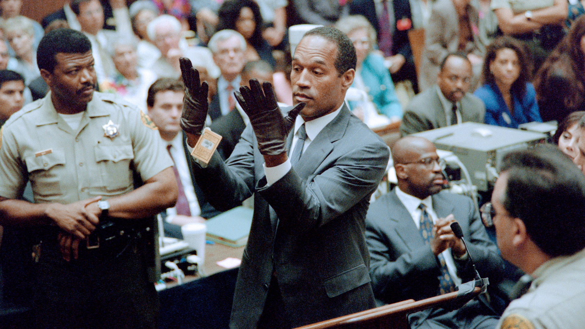 O.J. Simpson tries on gloves in court