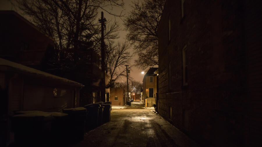 Dark and scary city alley at night