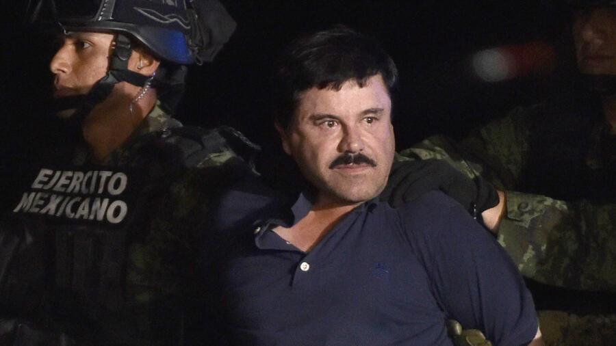 "Joaquin ""El Chapo"" Guzman is escorted to a helicopter"