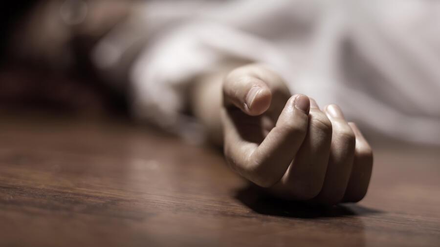 A conceptual photo of a dead woman's hand.