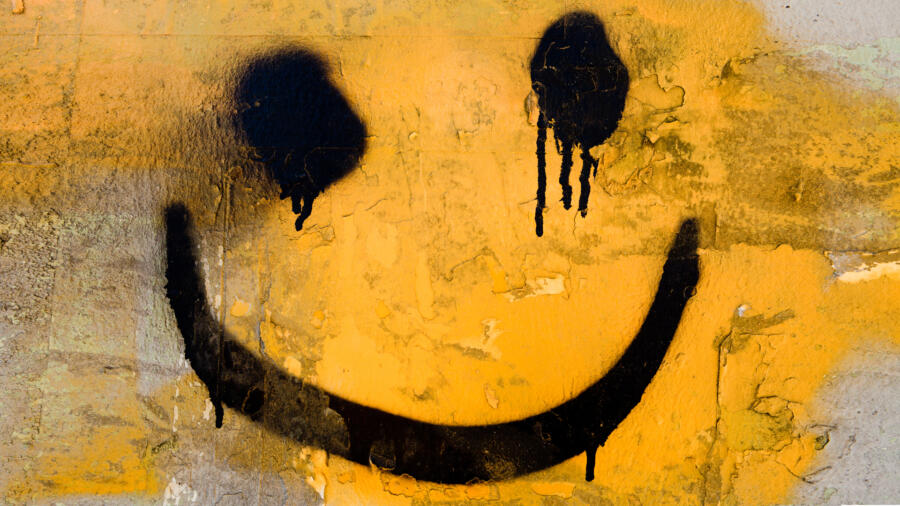 A spray painted smiley face