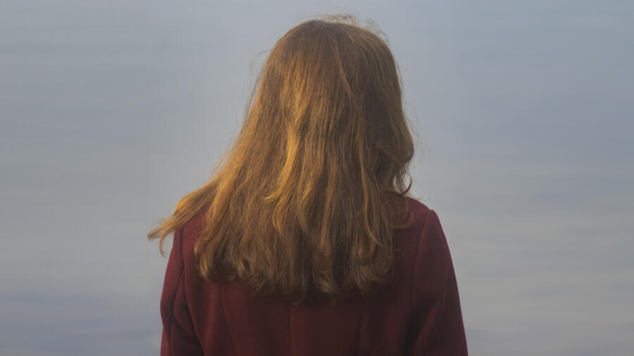 Photo of a redheaded woman standing outside